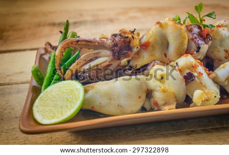 Grilled squid seafood sauce Thailand. - stock photo