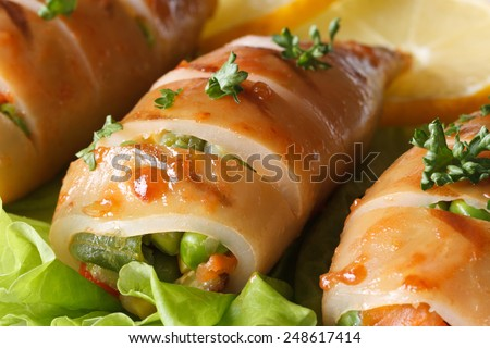 Grilled squid stuffed with vegetables on salad leaves macro. horizontal  - stock photo