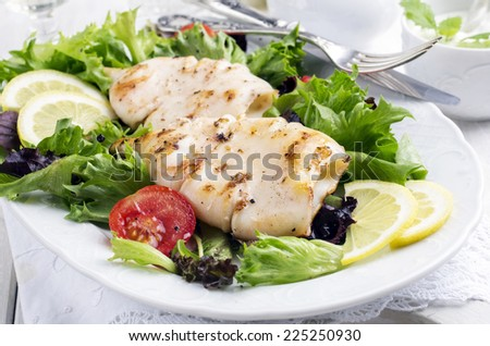 grilled squid with salad - stock photo
