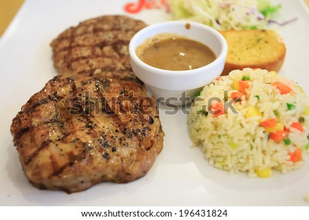 Grilled steak and fried rice - stock photo