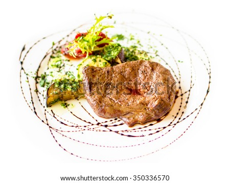Grilled steak and vegetables on white background. Restaurant food - meat dish, beef steak with sauce and garnish. - stock photo
