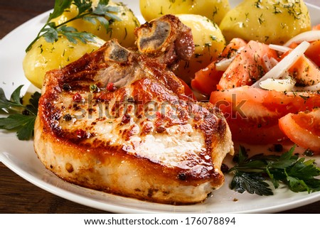 Grilled steak, boiled potatoes and vegetables  - stock photo