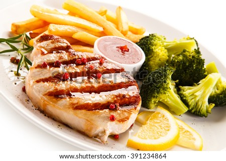 Grilled steak, chips and vegetable salad  - stock photo