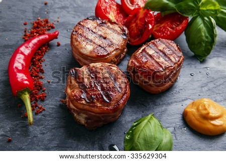 Grilled steak filet mignon wrapped bacon  - stock photo
