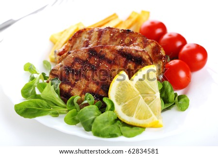 Grilled steak meat on a white plate on white isolated background