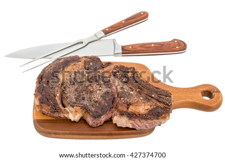 Grilled steak on cutting board, isolated on white - stock photo