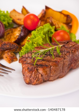 Grilled steak on wood - stock photo