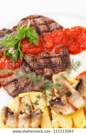 Grilled steak with baked vegetables