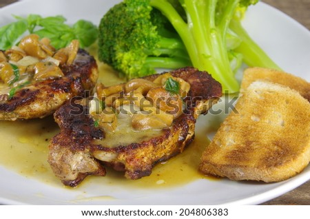 grilled steak with broccoli and chanterelle souce