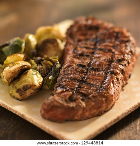 grilled steak with brussel sprouts - stock photo