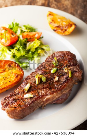 grilled steak with roasted potato  - stock photo