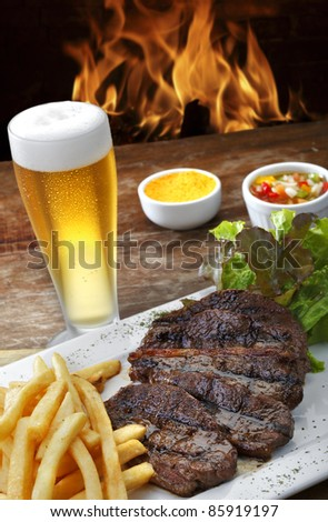 Grilled Steak with salad and beer - stock photo