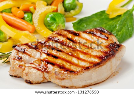 Grilled steak with vegetables on the plate - stock photo