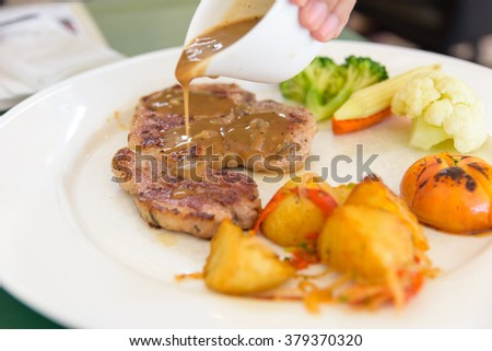 Grilled steaks, baked potatoes and vegetable