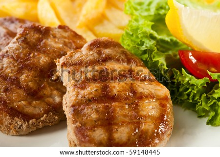 Grilled steaks with fries - stock photo