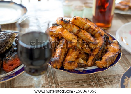 Grilled sturgeon fillets on a dining table - stock photo