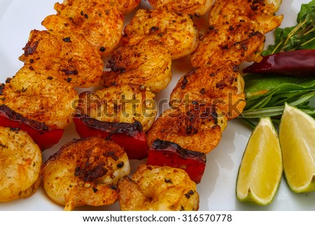 Grilled tiger prawn skewer with rosemary and spices