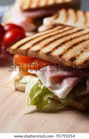 Grilled toast with ham cheese tomato and lettuce - stock photo