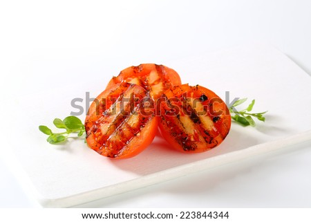 Grilled tomatoes - stock photo