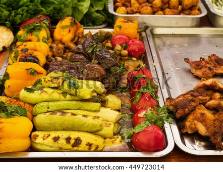 Grilled tomatoes, peppers, mushrooms, zucchini and eggplant. Street food, various vegetables