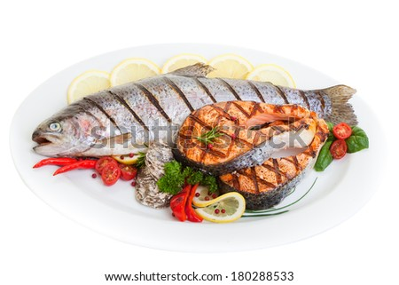Grilled trout and salmon steak with vegetables and oysters.