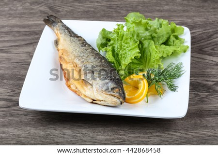 Grilled trout with lemon, dill and salad leaves - stock photo