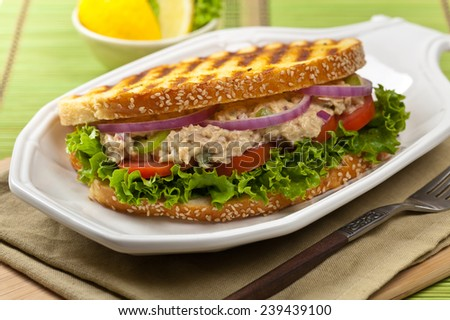 Grilled Tuna Panini Sandwich on a plate. Selective focus. - stock photo
