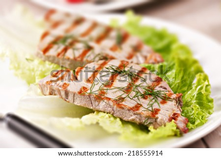 Grilled tuna with salad - stock photo
