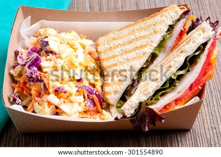 grilled turkey and cheese panini with home made cole slaw truck food style - stock photo