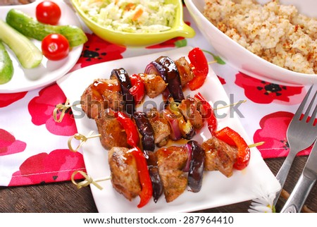 grilled turkey meat, red pepper and eggplant skewer with teriyaki sauce - stock photo