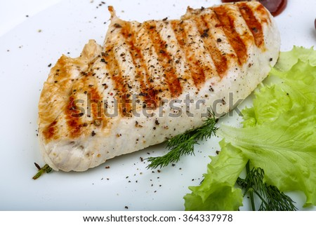 Grilled turkey steak with pepper, dill and salad leaves