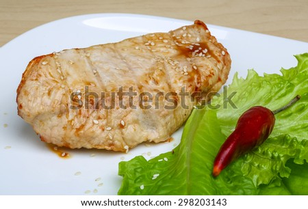 Grilled turkey steak with spices and salad leaves