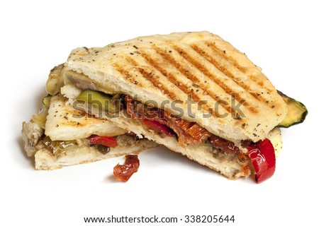 Grilled vegetable focaccia or panini isolated on white.  Delicious healthy sandwich. - stock photo