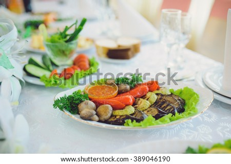 grilled vegetables on plate with red sauce