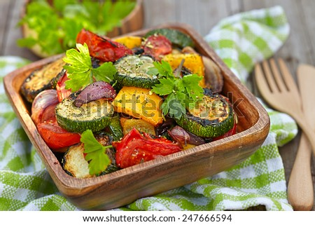 Grilled vegetables  salad with zucchini, eggplant, onions, peppers and tomato