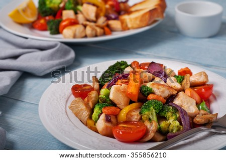 Grilled vegetables with chicken on wooden table. Top view with copy space. Food background