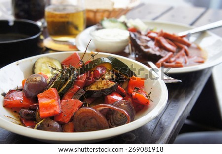 Grilled vegetables with spices on the summer terrace