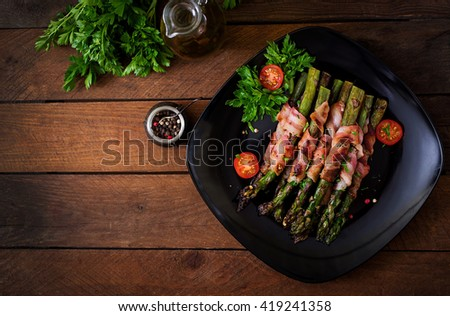Grilled violet asparagus wrapped with bacon. Top view - stock photo