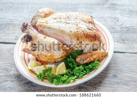 Grilled whole chicken - stock photo