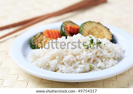Grilled zucchini and white rice - stock photo