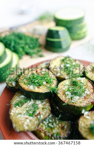 Grilled zucchini with garlic and herbs - stock photo