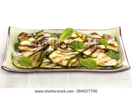 Grilled zucchini with mint.  Healthy eating. - stock photo