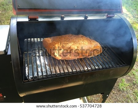 Grilling a butt and smoking it for hours