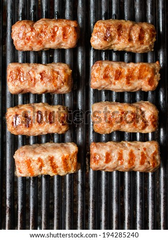 Grilling cevapcici on grill grate and served. Mouth watering photos of balkan food - stock photo