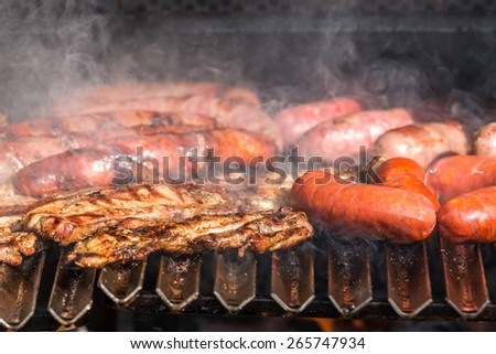 Grilling close up with sausage - stock photo