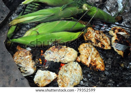 Grilling Corn and chicken Outside on the grill - stock photo