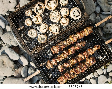Grilling mushrooms with blue cheese and pork - stock photo