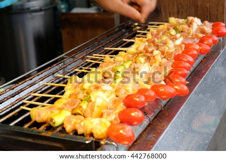 Grilling pork and Vegetable on barbecue grill thai style