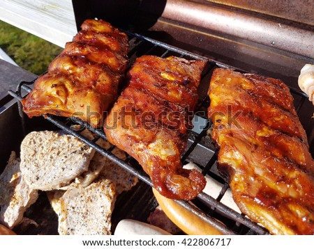 Grilling pork loin ribs, on a gas barbeque