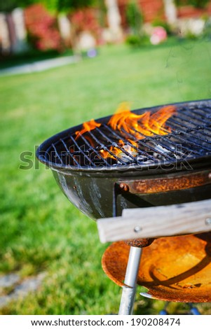 Grilling theme with barbecue stuff. Kettle barbecue grill. - stock photo
